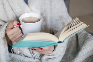 woman with a book and hot coffee