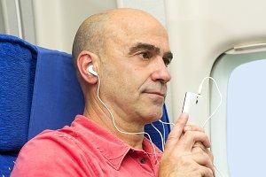 passenger in plane with headphones