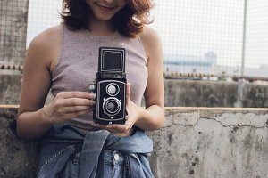 woman using film camera