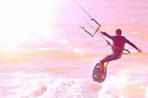 Kitesurfer at sunlight.