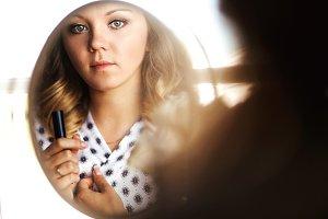 Blonde woman near the mirror