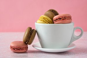 Macarons in a white cup