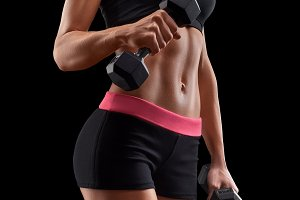 Pumping up muscles with dumbbells