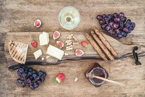 Glass of white wine & cheese board