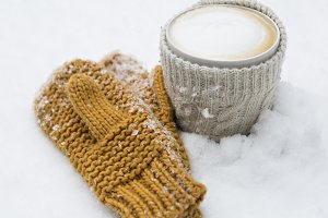 coffee and gloves in the snow