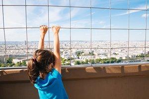 Little girl in the Eiffel Tower