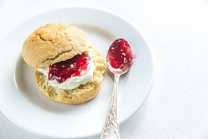 Scone with cream and cherry jam