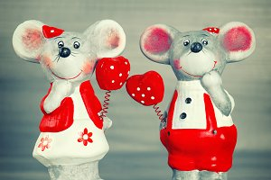 Cute mice with red hearts