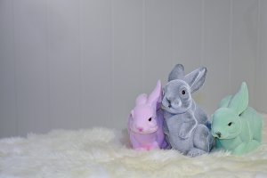 Three colored plastic furry bunnies