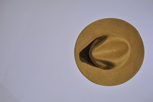 Brown straw hat on a white table