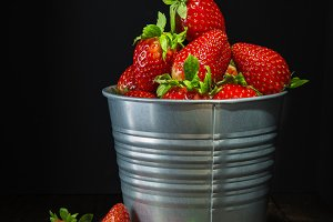 Fresh strawberries in a bucket