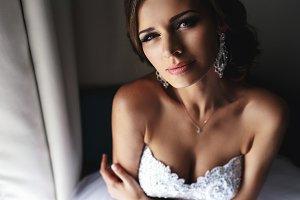 Stylish bride in white dress