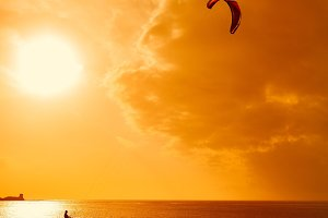 Kitesurfer as sunlight.