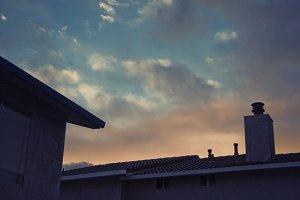 Peach Sky Over Rooftops