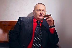 Boss smoking cigar