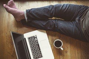 Man using laptop on floor