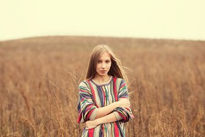 hippie girl among a field