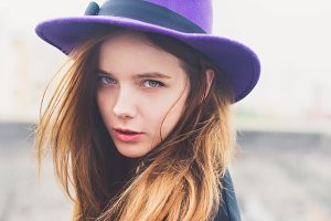 beautiful girl in purple hat