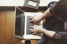 Man sitting on floor with laptop
