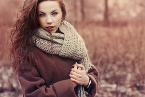 girl in a coat and scarf