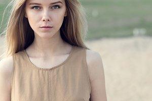 blonde in beige dress