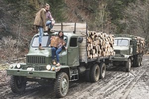 Man and woman in the forest on truck