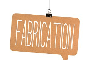 fabrication word on cardboard