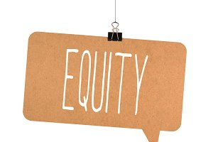 equity word on cardboard