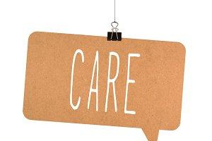 care word on cardboard