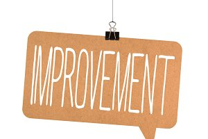 improvement word on cardboard