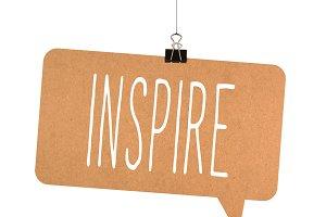 inspire word on cardboard