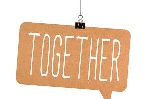 Together word on cardboard