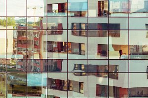 Modern building reflected on glass