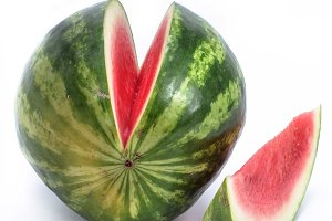 Water melon with one slice on white