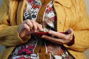 Old woman and electronic tablet
