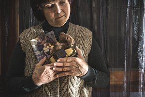 Senior woman hold picture of childre