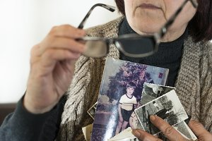 Senior woman watching old photos