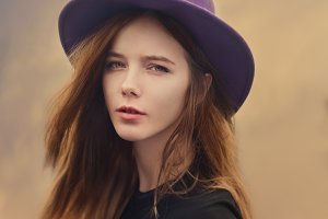 brunette in a purple hat
