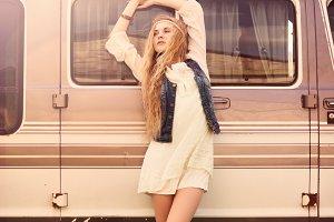 hippie girl near the car