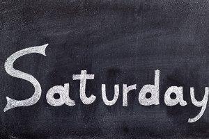 Saturday handwritten on blackboard