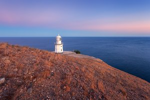 Lighthouse on the hill at sunset