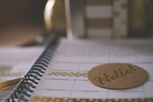 Hello coaster on desk planner
