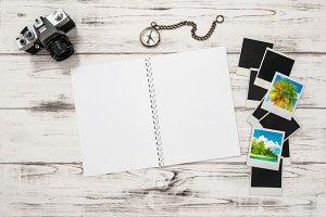 Open travel book, polaroid frames