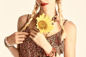 Hippie boho woman with sunflower