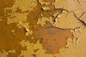Texture of cracked yellow paint