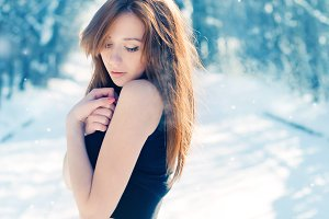 Beautiful girl freezes in winter
