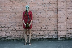 beautiful young girl in a gas mask