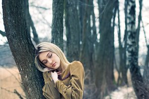 blonde in a winter forest