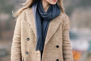 Woman in coat with scarf