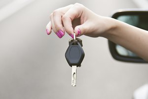 hand car key to travel